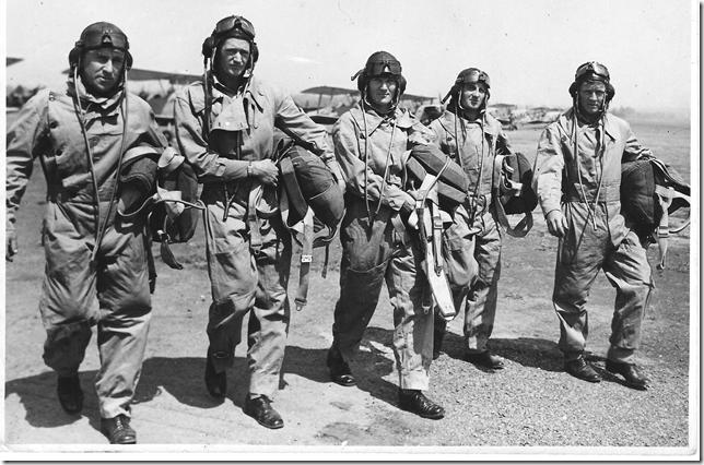 Cliff Kingsford-Smith, Jack Sandilands, Ted Williams, Ken Ross and Jack Steele at Archerfield airfield.